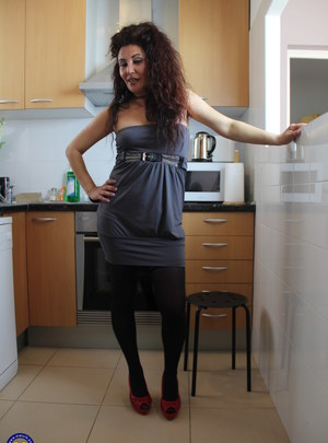 Naughty Spanish housewife playing in her kitchen