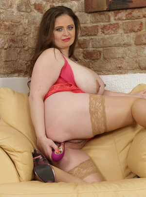 Curvy big breasted housewife masturbating on the couch