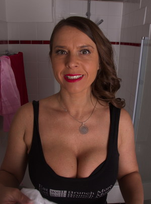Hot German MILF taking a shower and plays with her big tits