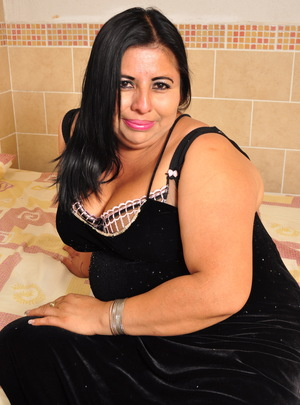 This big Latin mama loves to play by herslef