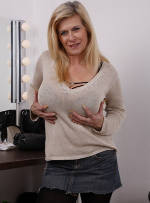 Big breasted German housewife showing her pierced pussy from Mature.nl